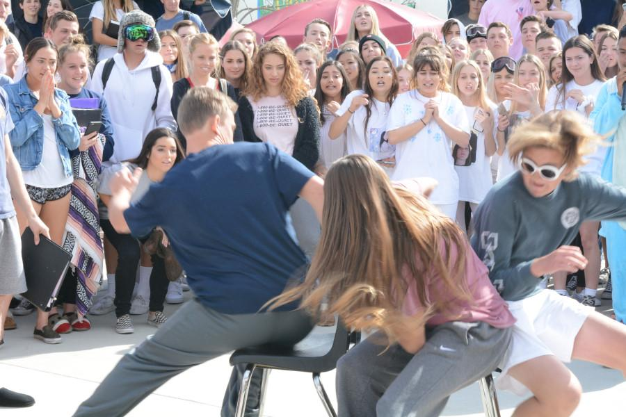 Senior Danielle Satterwhite loses her chance to grab a chair as junior Teddy Conover steals the seat at the last second during musical chairs.