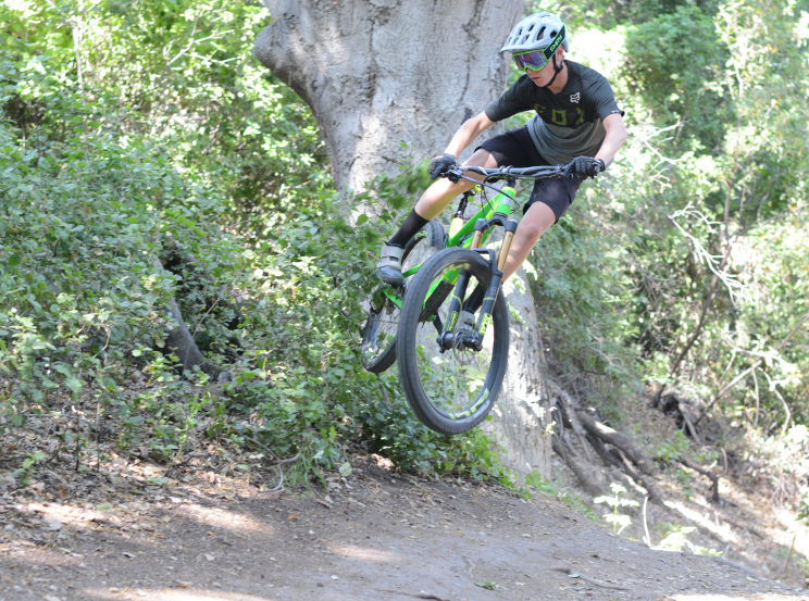 Gavin+Fluegge+goes+off+a+jump+and+throws+a+whip+through+a+bush+at+Waterworks+in+Rancho+Santa+Margarita.+He+has+been+biking+for+two+years+and+now+is+sponsored+by+and+rides+for+the+Intense+race+team.