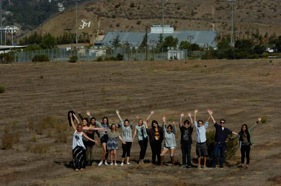 OUTSTANDING IN THEIR FIELD: The 2013-14 Express Newspaper staff. From left to right: Mekenna Szabo, Macy Drew, Parker Discala, Courtney Crane, Alexea Malaletkin, Makayla Thomas, Brittany Christensen, Nikki Rastegar, Jenna Clemente, Griffin Orlich, Shane Battis, Tracy Gaylord, and Chetana Piravi.