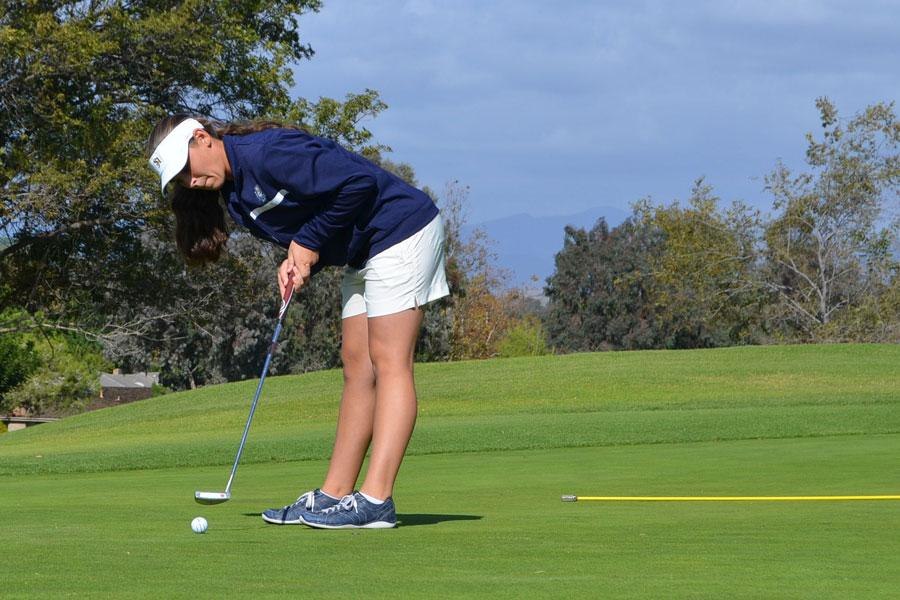PLUNK: Haley Heesch, Varsity player, sinks her putt for a par on the first hole of the match against San Clemente High School. Photo by Shane Battis.