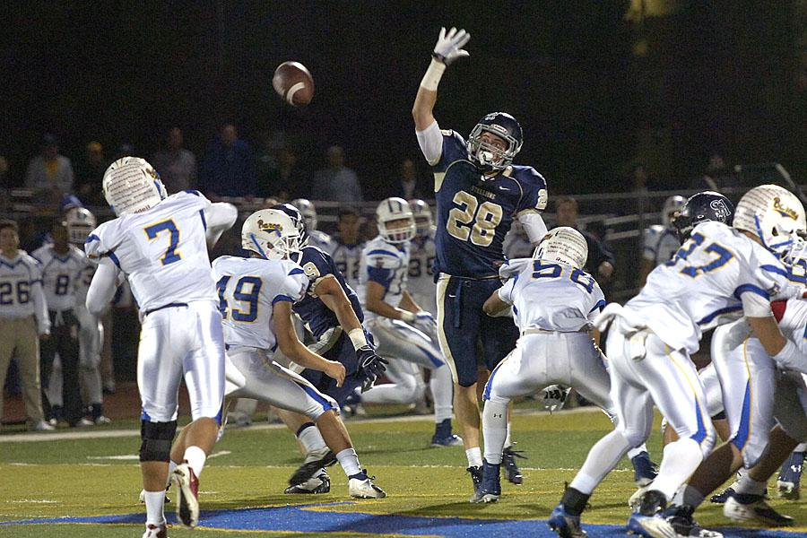 Tim Newman (10) reaches up to block a pass. The Stallions defeated their opponent, Fountain Valley, 28-27.