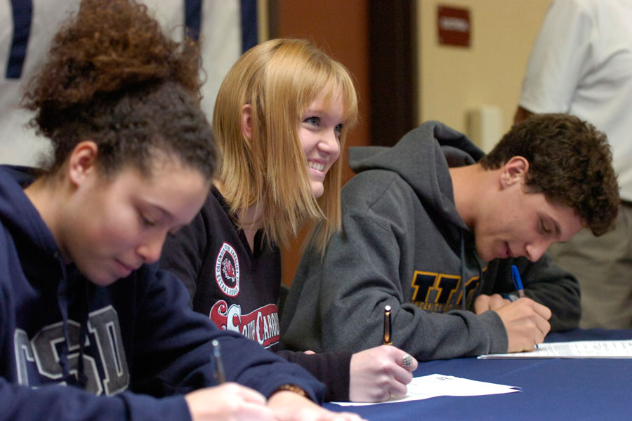 Ariana Conklin (left), Courtney McKeag (middle), and Logan Zotovich (right) commit to play as college athletes for their future colleges or universities by signing letters of intent.