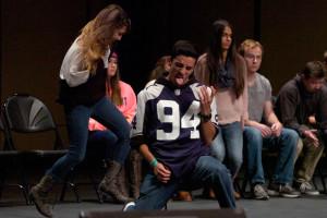 Jaimz Metcalf plays air gutair on stage.