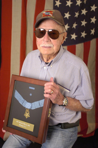 Retired campus supervisor, Bob Nietzel holds the Medal of Honor awarded to his cousin Alfred B. Nietzel.