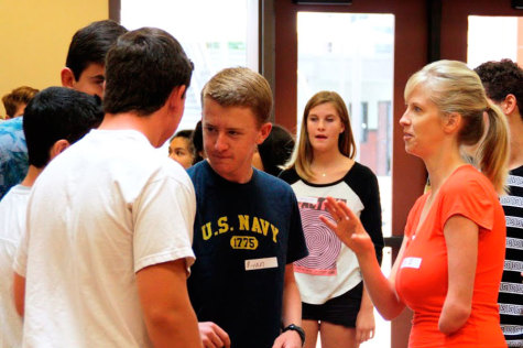 Link Crew adviser Kimberly Stanga works with the link crew leaders, teaching them how to properly introduce themselves to the freshmen at orientation. Ryan Brown (11) listens carefully and plans his introduction. Photo by Macy Drew