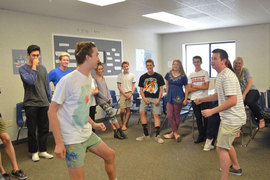 Cole Henriksen (12) and James Garwood (12) are in a heated competition for a spot on the comedy sports team.