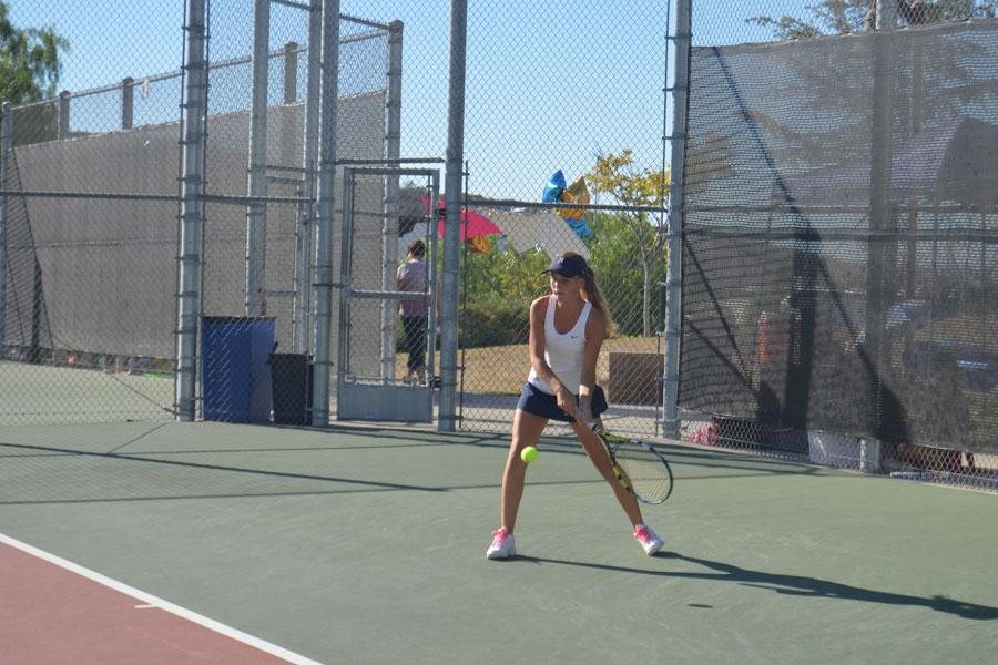 Tess+Smolders+%2811%29+makes+a+great+play%2C+helping+the+varsity+tennis+team+win+league+champions+of+2014.
