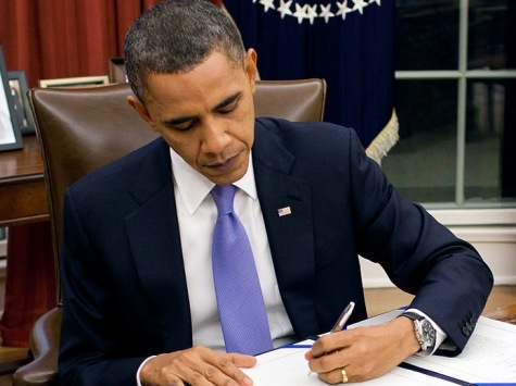 President Obama takes action at the Resolute desk. Many times, he has claimed he can and will utilize his pen to exercise unconstitutional authority via the Executive Order.