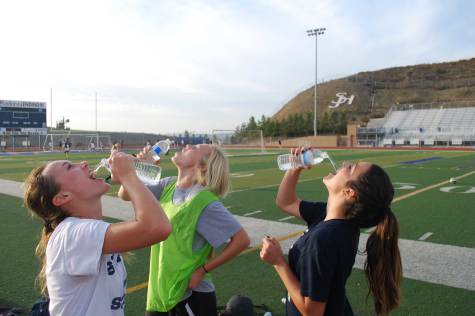 THIRSTY FOR SOME WATER: After a tiring practice of soccer, Amanda Gould (11), Natalie Blackwelder (10), and Lexi Ortiz (10) decide to hydrate up on some water. Water has become scarce in California due to the drought. Hydration is the main key to keeping in tip top shape when being an athlete.
