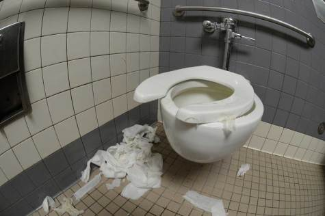 BREAKING SPIRITS BY BREAKING TOILETS: 37% of students polled said the H building boys bathroom was the dirtiest bathroom on campus, followed by buildings C and E. 63% of students were most to blame for the bathroom related problems. Photo by Andrew Fehlman