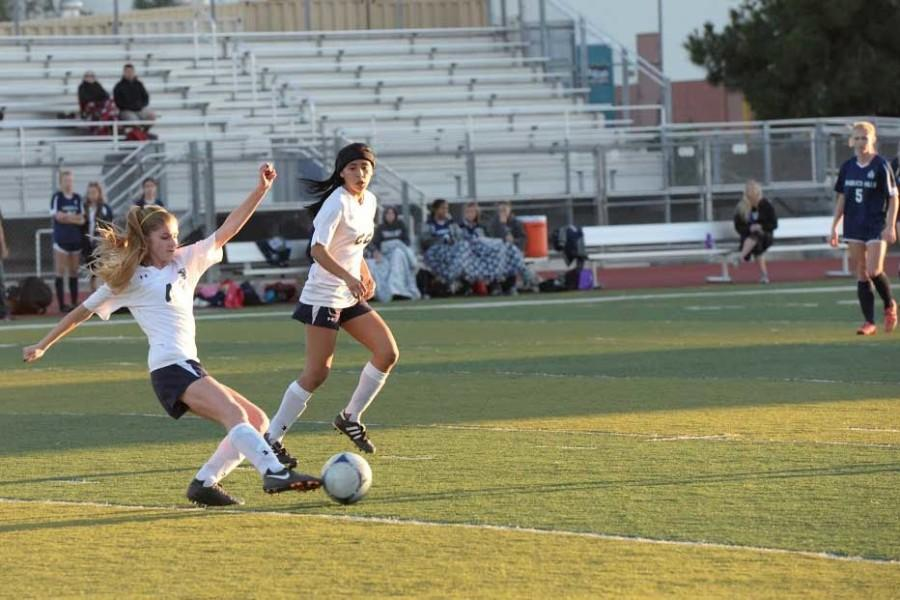 A Stallion player  passes the ball to her teammate as Destiny Rivera (11)  supports her teammate.