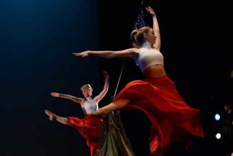 LIBERTY LEAP: Bethany Nicol is patriotism personified as she leaps center stage in the dance inspired by the heroes depicted in the statue, Iwo Jima by Felix de Weldon. Each of the performances in the show (titled Masterpiece) was inspired by art pieces from all different cultures and time periods. Photo by Maggie Barnes and Ellie Holt