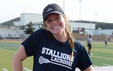 FISHING FOR INSPIRATION:  Journey Fischbeck (11) was unable to play for 30 days due to CIF transfer rules, and became a temporary coach to the girls varsity lacrosse team. She prepares to help lead the team to victory on the sidelines until she can get back on the field. Photo by Kaela Lawson.