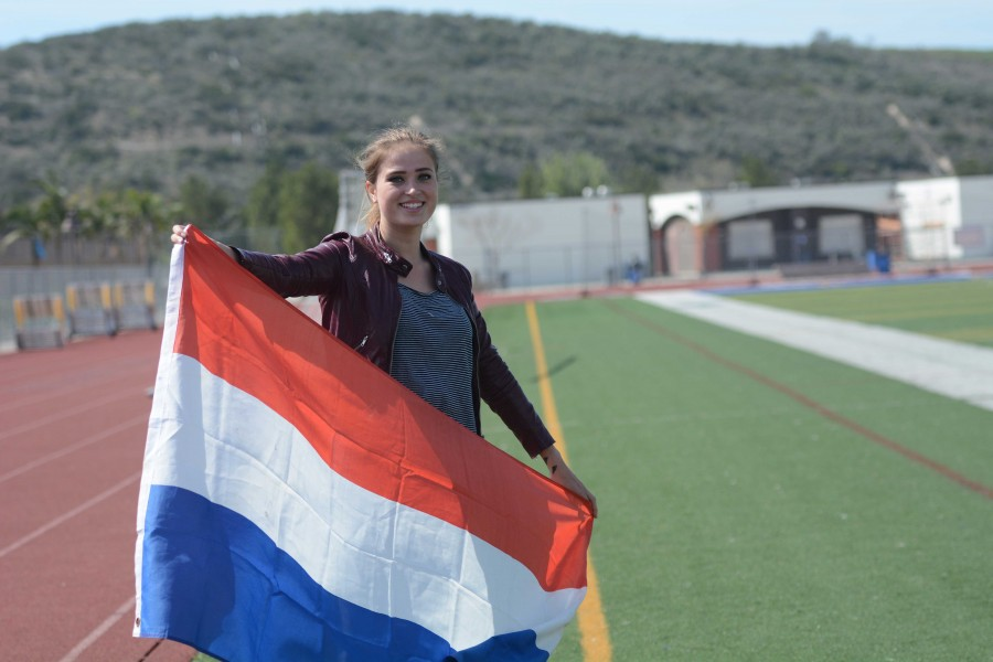 Maud+Van+Den+Elshout+%2811%29%2C+SJHHS%27s+newest+exchange+student+from+the+Netherlands%2C+poses+on+the+lacrosse+field+with+her+home+country%27s+flag.