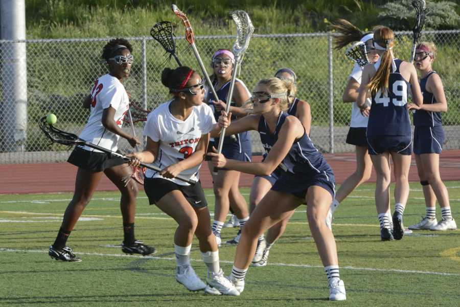 Midfielder Taylor Austin (10) firmly stands her ground against San Clemente's Shay Heft (10) as she drives to goal, contributing towards the 12-10 win.  The Stallions are headed into a great season, with a 9-1 overall record.
