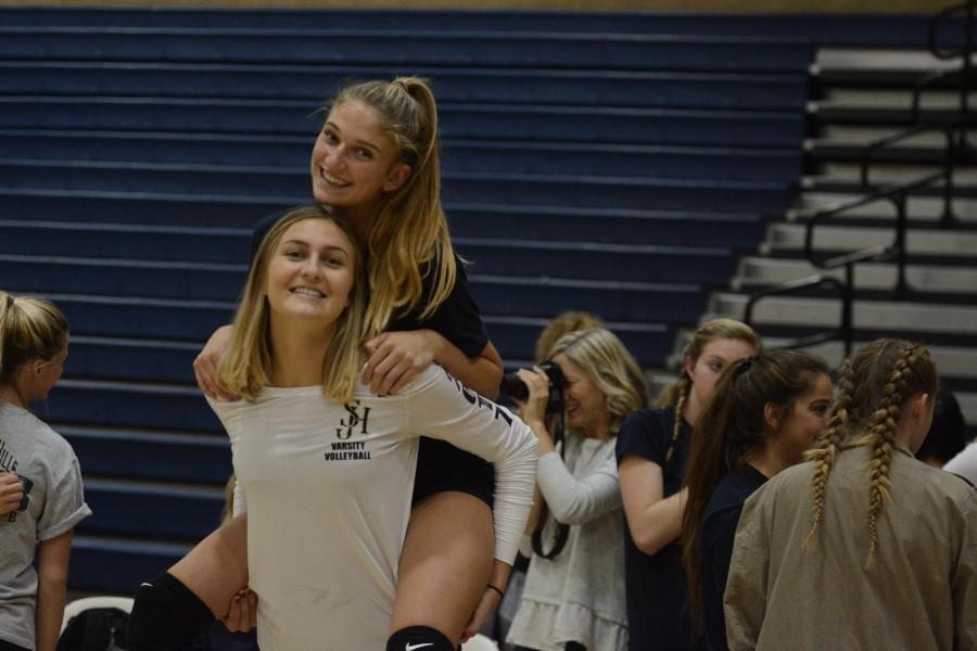 Madi Mercer (12) gives  Katie Lukes (11) a piggy-back ride at one of the games, fully displaying how their silly and sweet dispositions form such a great friendship.