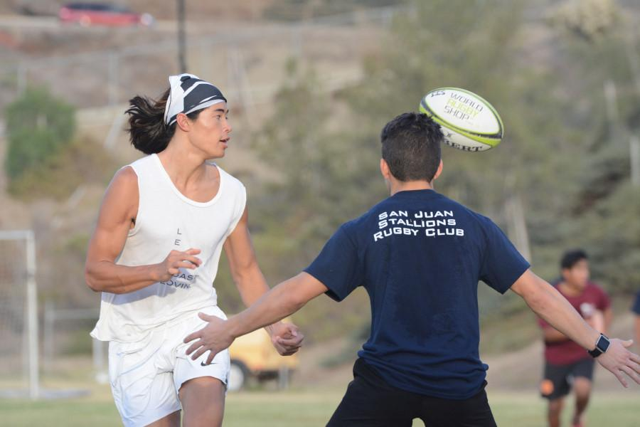 Team member, Danny Olswang, completes a pass before darting around a defender at practice. The team is preparing for their first game, a friendly scrimmage, against Dana and San Clemente December 3rd