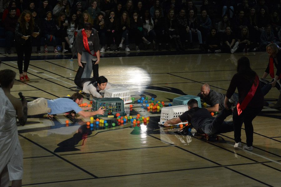 "During the Pep Rally, the teacher formal court participated in a round of ""Hungry Hungry Humans."""