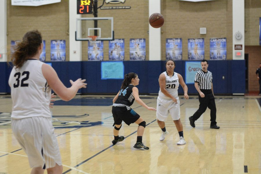 Junior Jada Forsdick-Stevenson passes the ball to Hadley Dayton, one of the seniors who was recognized that night.