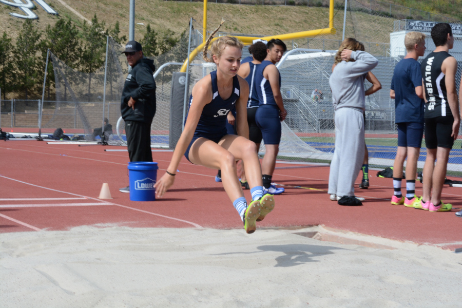 Brinley Hawkins (11) takes her first attempt at the long jump.