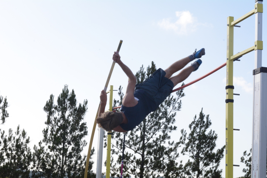 Aleck Gloude (11) participates in the men's pole vault. He holds form but unfortunately fouls, knocking the crossbar from the pegs in the attempt.