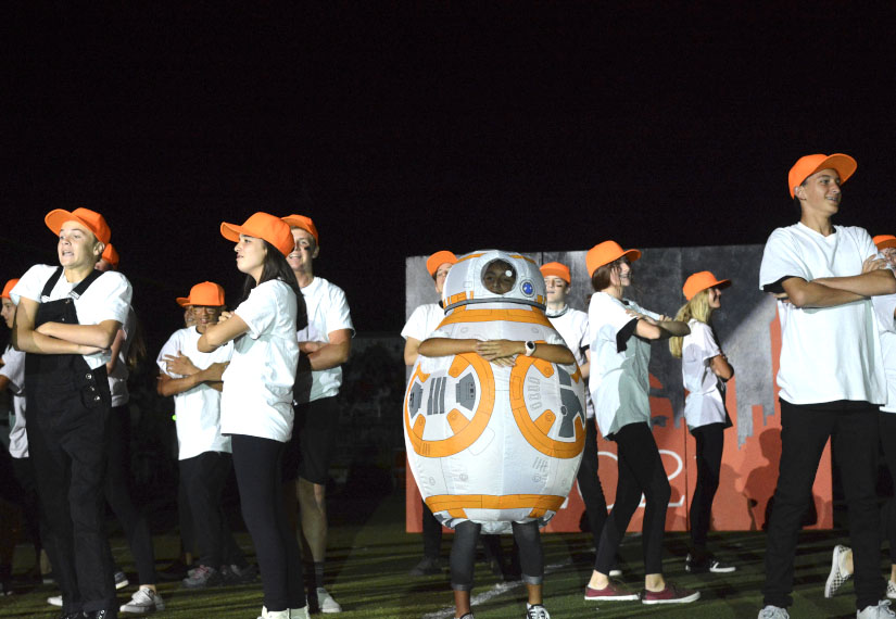 BB8 leads the freshmen, representing the droids, in the first dance of the homecoming halftime show. This dance is choreographed and performed by the students during the Homecoming Football Game.