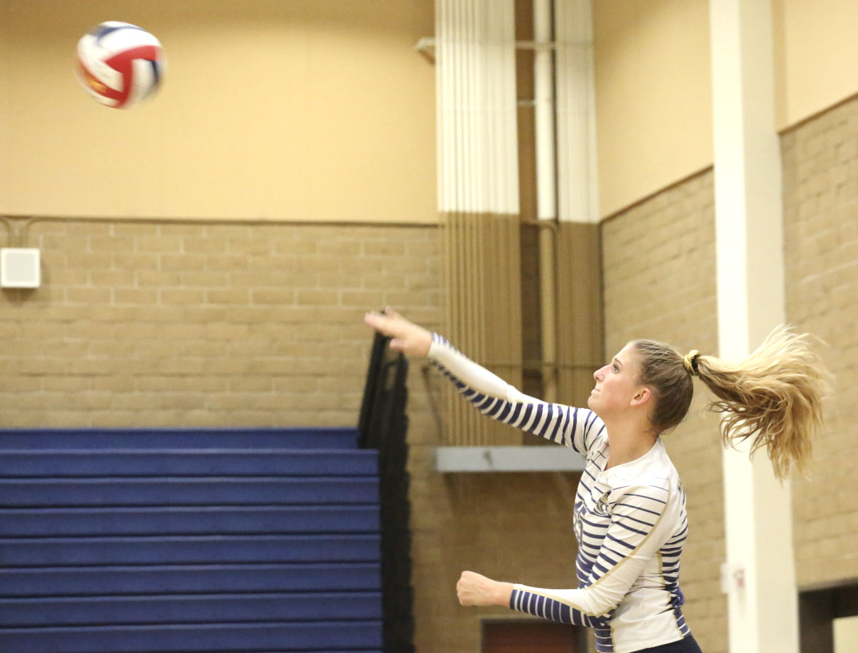 The Stallions played Saddleback Valley Christian School in a non-league game on Friday the 22nd. Katie Lukes is pictured above serving the ball during the varsity game.