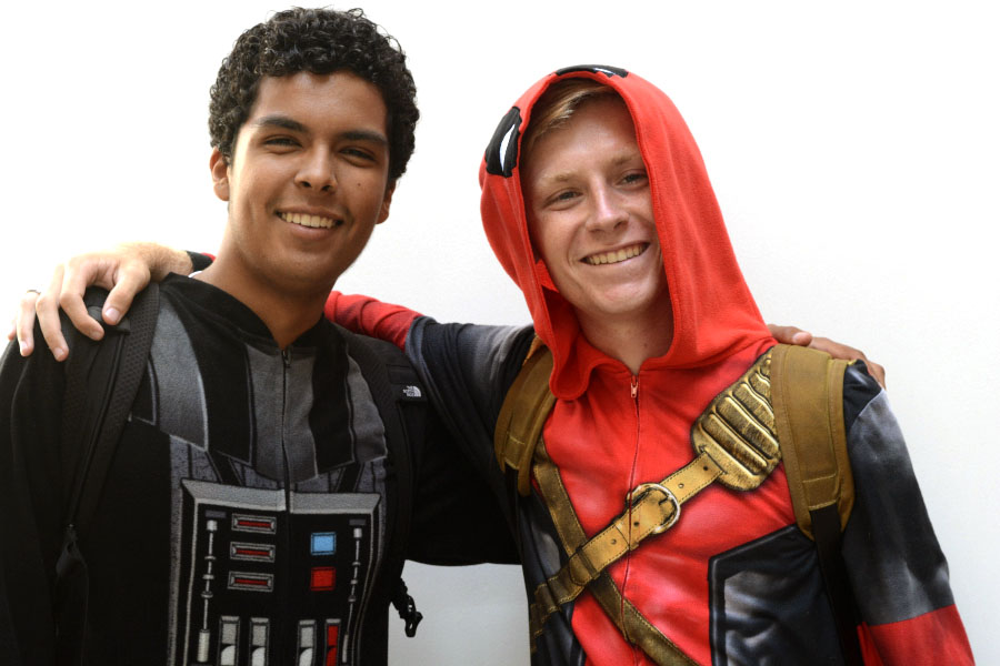 Seniors Noah Villar, as Darth Vader, and Dalton Bourne, as Deadpool, pose in their onesie pajamas to show their school spirit on the first day of Homecoming Week. Students were invited to dress up in their pajamas for the day to celebrate the beginning of the school year and the Homecoming activities.