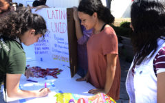 A student leaves their name and contact information the Latino Unid club.