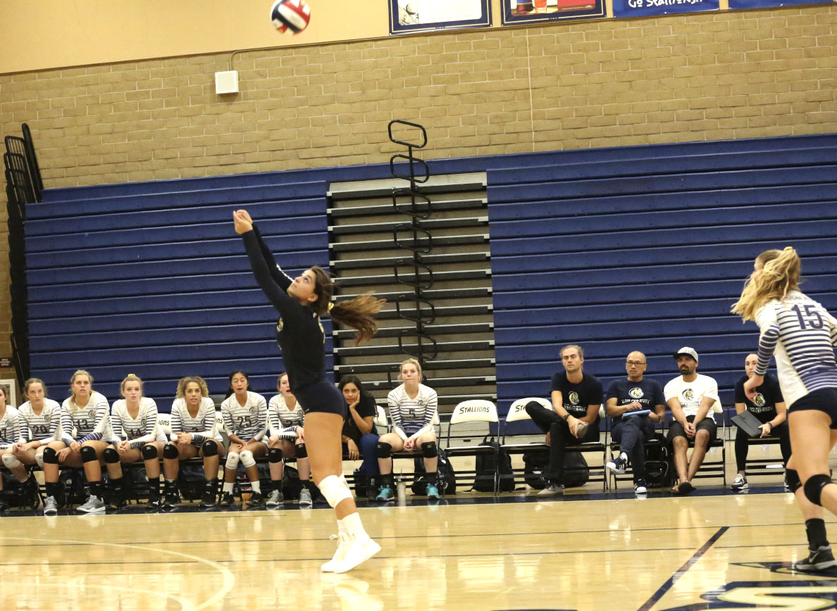 Gabby Bellizzi, committed to UC Berkeley, passes the ball to team mate, Katie Lukes, committed to USD. The Stallions are undefeated league champions for the third year.