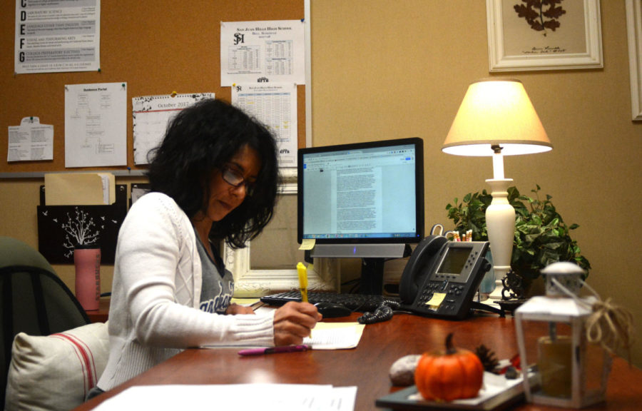 Academic Advisor Lisa Cassarino works on senior letters of recommendation for colleges after the drop window had closed.