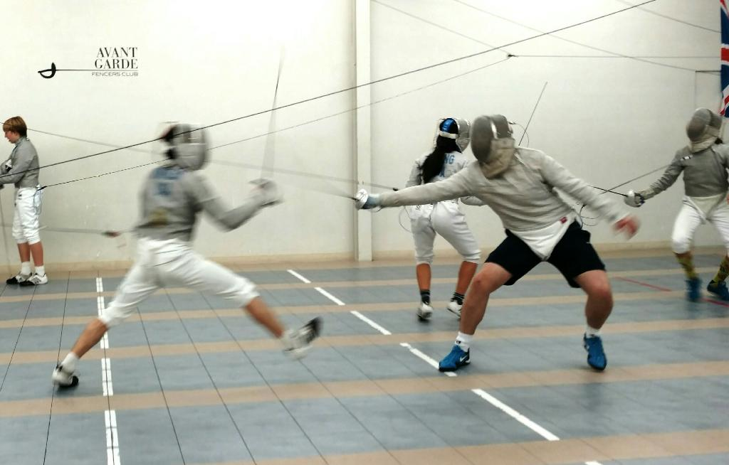 Lucas Winkler (right) is competing in a practice sabre fencing match against another member of his fencing club, Avant Garde Fencing. He travels to LA to practice 3-4 times a week.