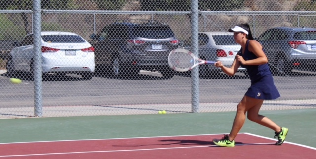 Varsity captain Kelley Green (12) hits a forehand in practice. The girls hit between 50-100 forehands a day in order to hone their skills for matches. They would also practice backhands, volleys, overheads, and serves. Green played line one doubles with her co-captain, senior Reese Thomas.