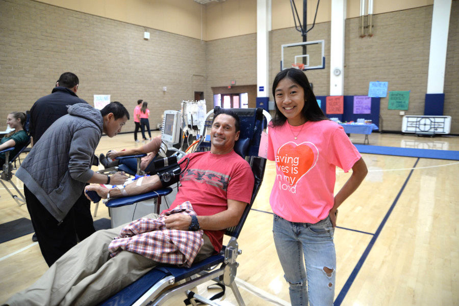 FCA club sponsored a Blood Drive in the small gym to save lives. Senior Kennedy Lim and SJHHS parent donating blood and contributing to the cause.