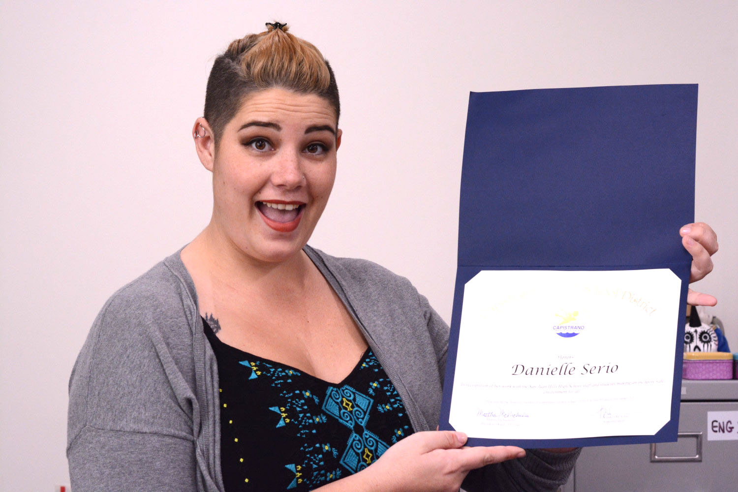 Danielle Serio holding the certificate for the