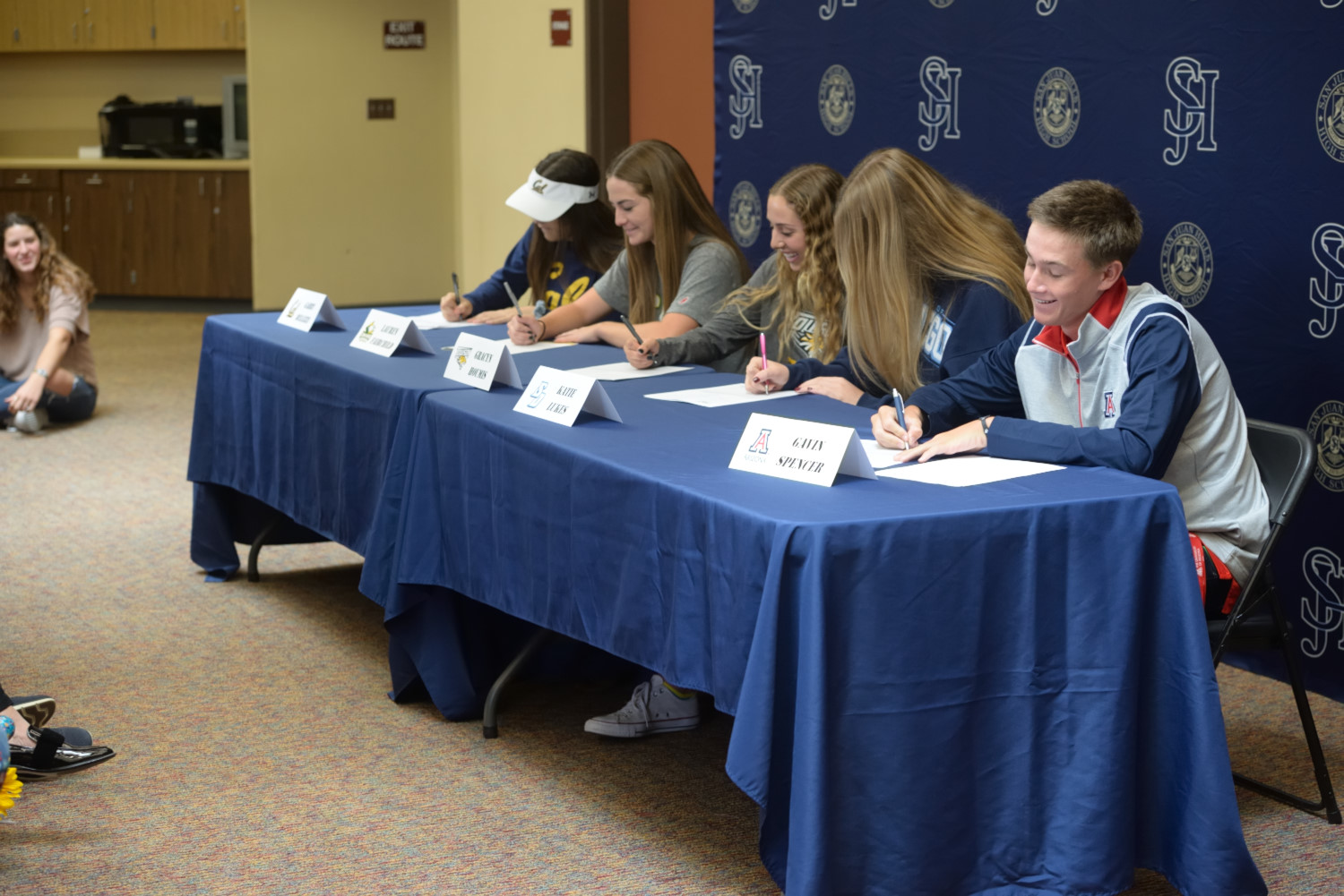 Five Stallion athletes (from left: Gabby Bellizzi, Lauren Fairchild,  Gracyn Houmis, Katie Lukes, Gavin Spencer) officially sign their Letters of Intent.