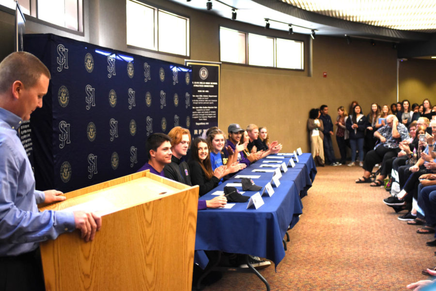 Students+at+SJHHS+sign+their+letters+of+intent+to+colleges+that+have+offered+them+scholarships+to+compete+in+their+athletic+programs.