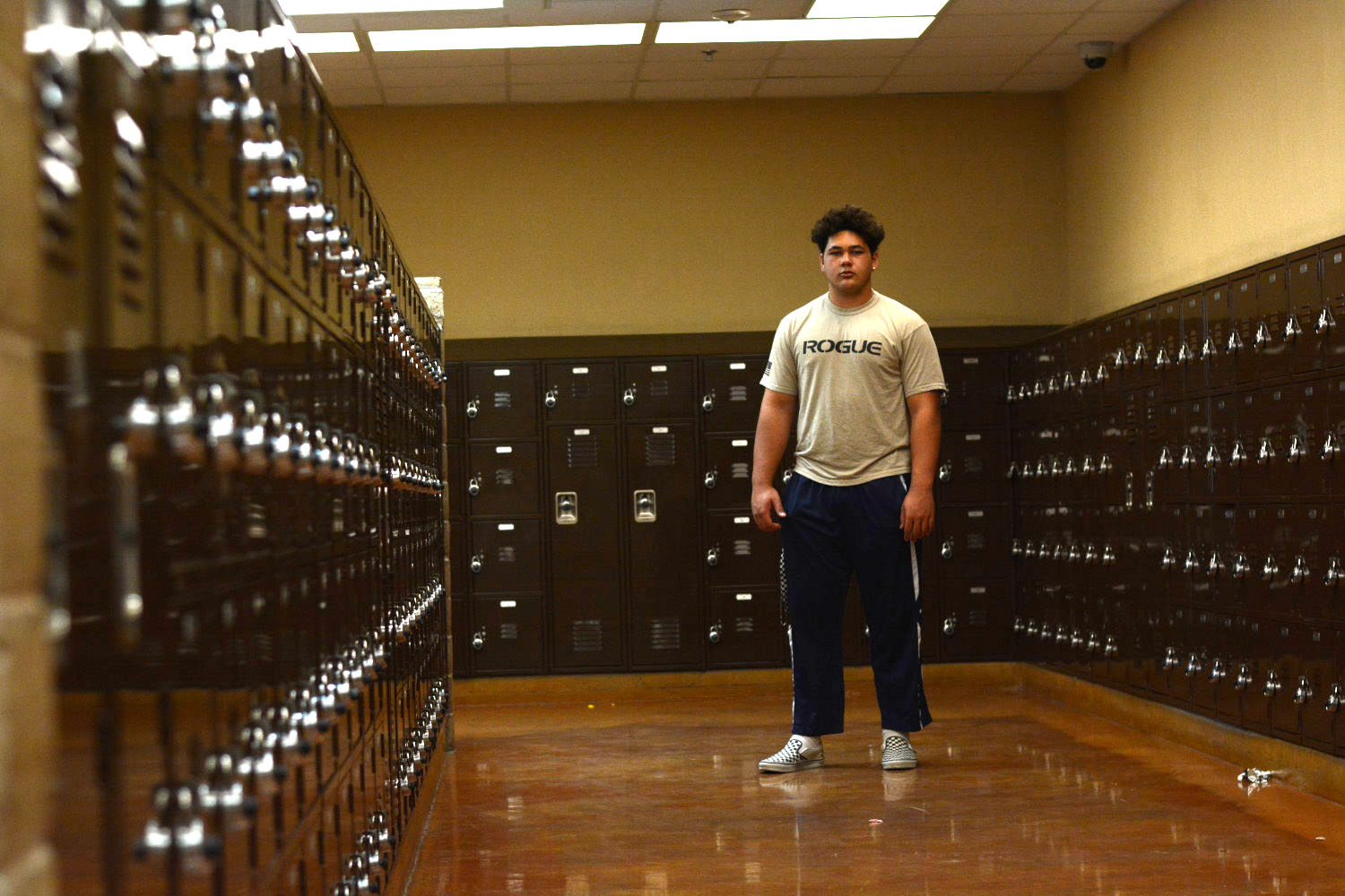 Sean Rhyan stands among the D building lockers at SJHHS.