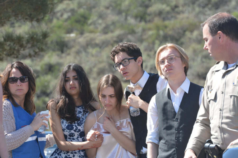 Student actors Anam Faruqi (12), Calista Henson (12), Noah Salviati (12), David Nielson (12), portray witnesses reacting to the two car collision. After calling 9-1-1, the students watched volunteers and officers rescue the accident victims.
