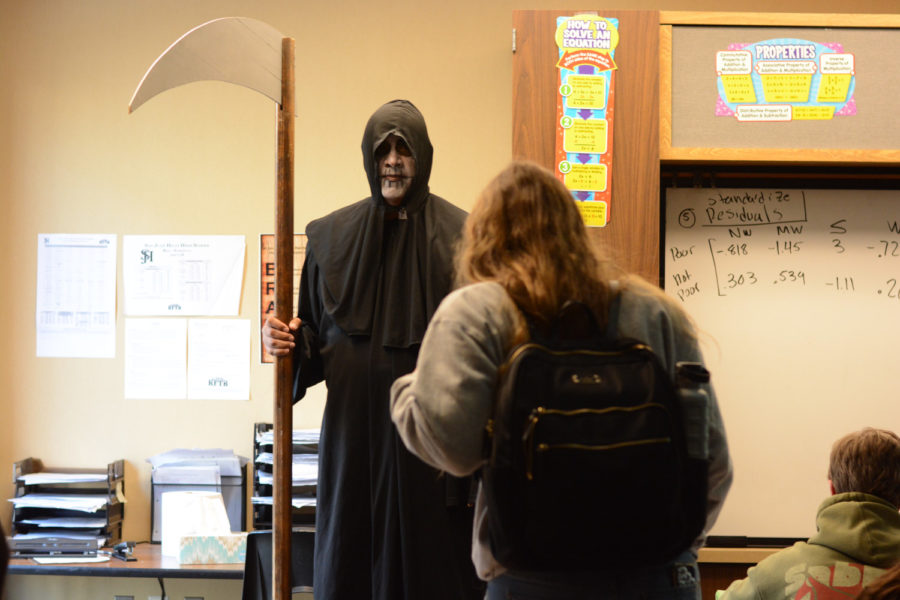 """Sam Newman (12) is removed from her statistics class by the Grim Reaper -- representing death. Sam was a participant of the living dead and was """"killed"""" during second period."""