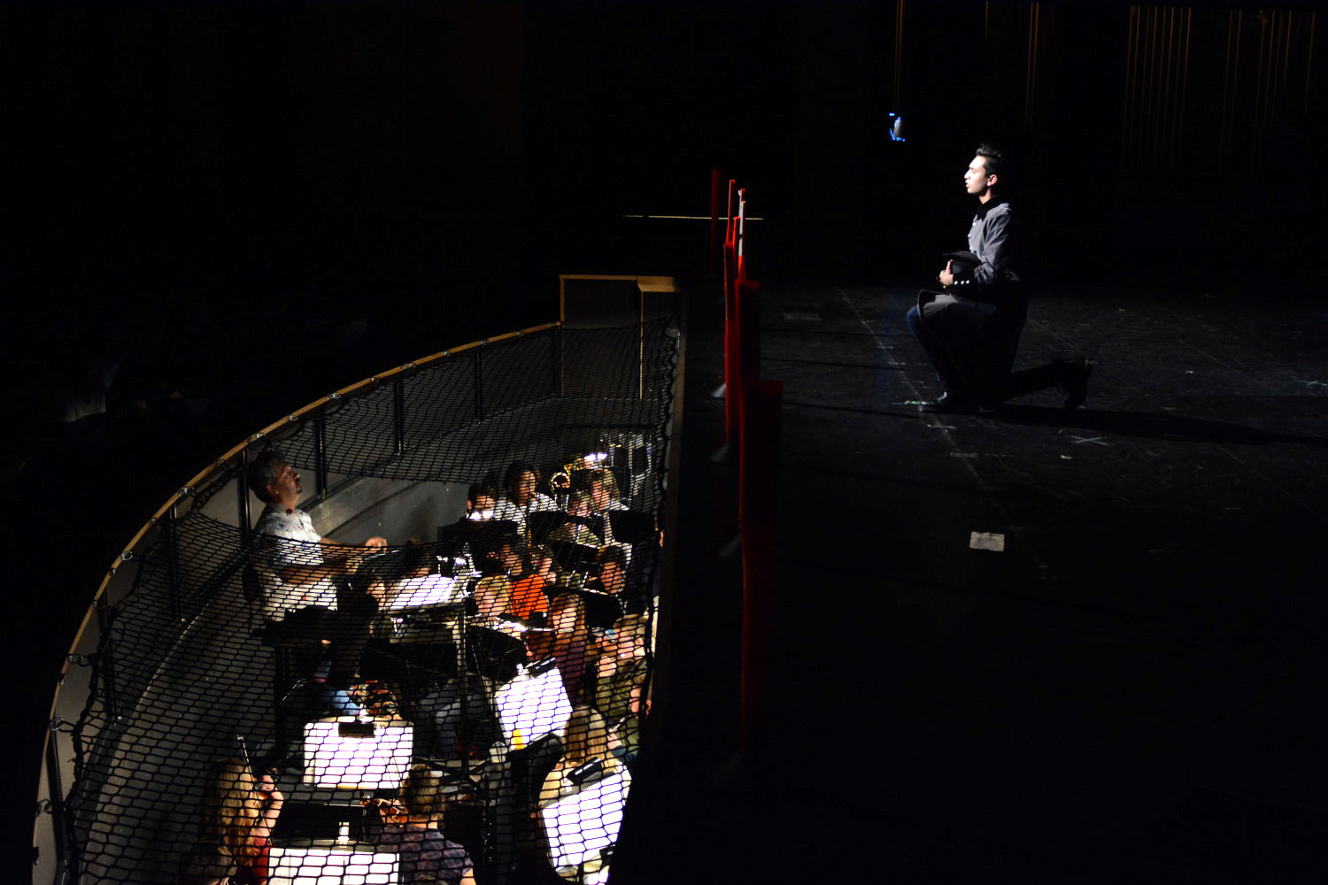 Javert, the antagonist,  played by Zain Farqui (11), displays his trouble over protagonist Jean Valjean's, played by Jaymes Macabale (12), evasion of the law. His performance is brought to life by the pit orchestra.