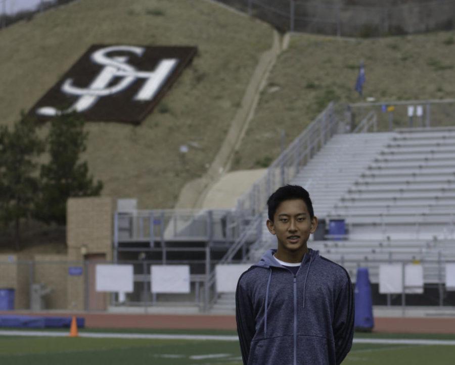 Tony+Wang%2C+freshman+varsity+kicker%2C+stands+in+The+Badlands+stadium+at+SJHHS.
