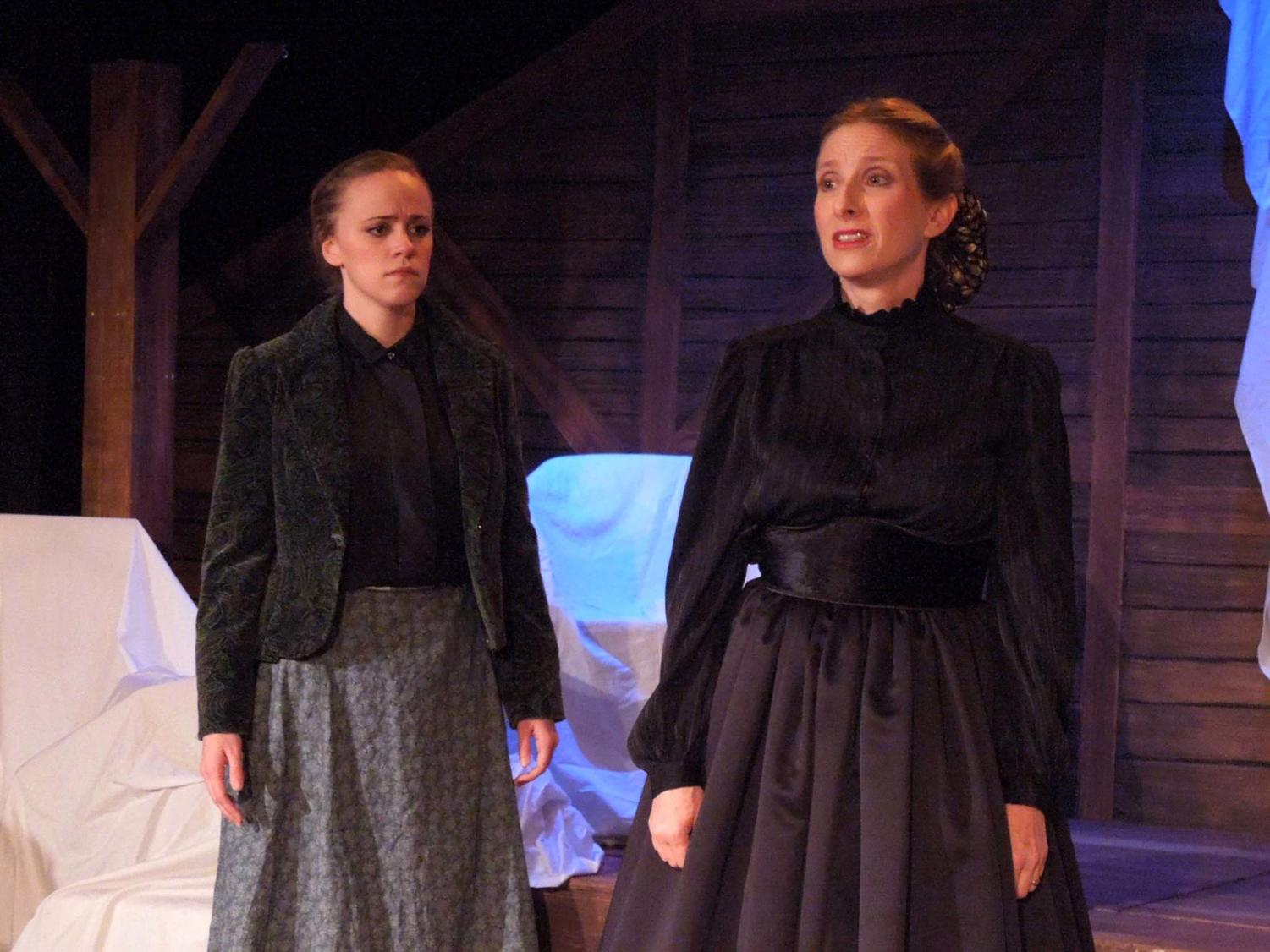 Emily Price acts as Marmee in the play, Little Women, accompanied by her colleague, Jo, at the Costa Mesa Playhouse.