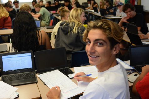 Some eligible SJHHS students register to vote during tutorial on October 2. Keegan Bengelsdorf (10), smiles while filling out his voter pre-registration form
