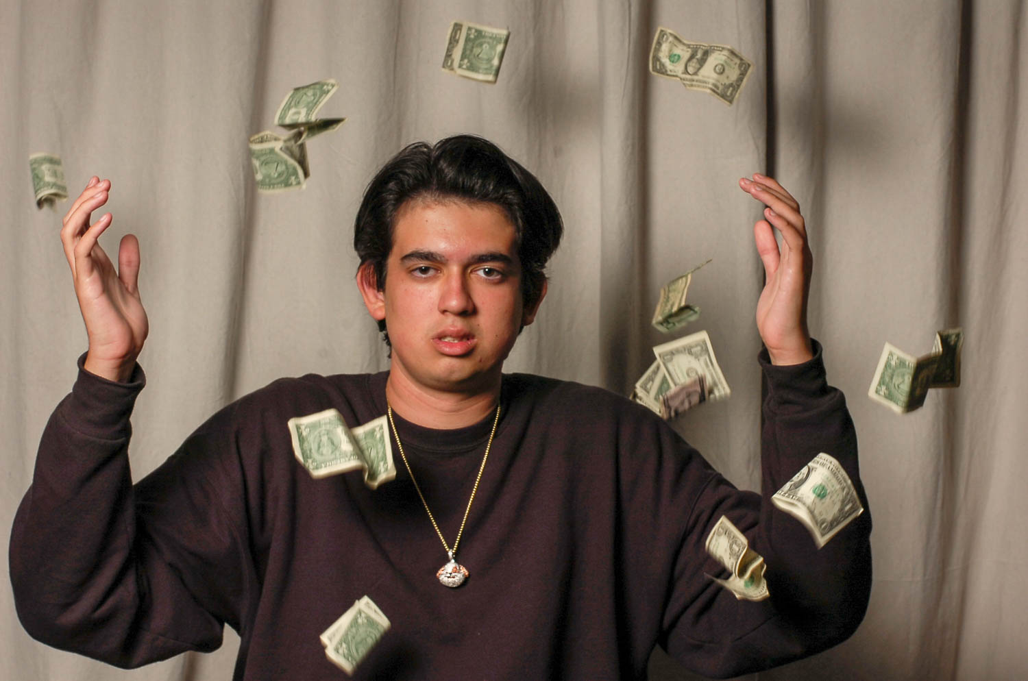 """Alec Tighe (12) showers in dollar bills after releasing his first debut album, """"Alectober,"""" on Soundcloud, October 25."""