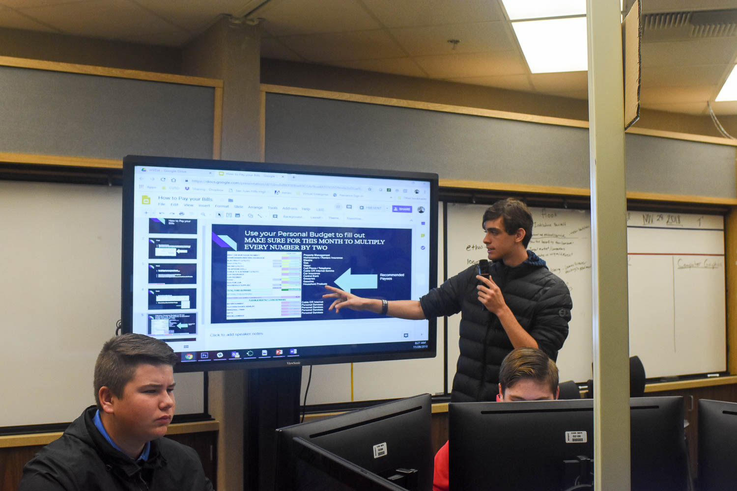 Jimmy Wale (11) conducts a presentation to the virtual enterprise class during second period on Thursday, November 29.