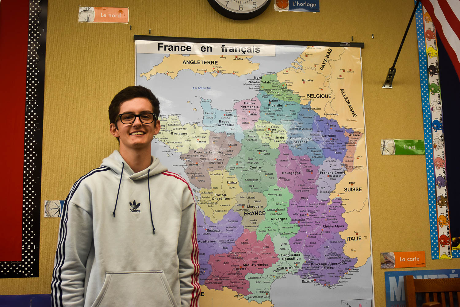 George stands in front of a map of France inside Mrs. Keller's French classroom. His home of Compiegne, France is in the Northern region of the country.