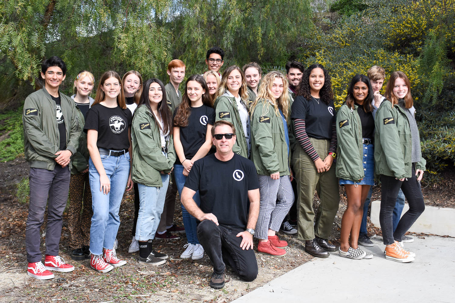The 2018-2019 Express staff wearing shirts that quote California Education Code 48907.