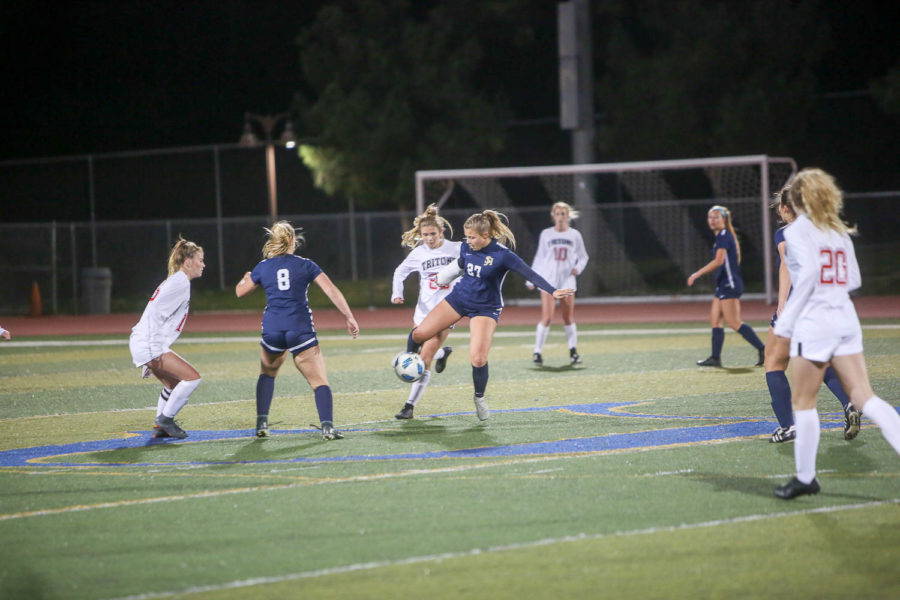 Lauren Precioso attempts to keep possession of the ball away from the Tritons and pass it to one of her teammates. San Clemente and San Juan would tie in the end 1-1