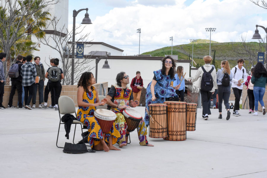 West African drummers using a djembe (rope-tuned skin covered goblet drum) to share and educate San Juan students on their cultural music.